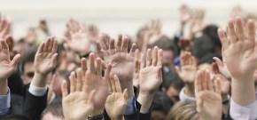 slider_3_crowd_of_hands_raised_1920x900