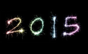 2015 New Year celebration with the date outlined by colourful fiery sparklers on a dark New Year's Eve night